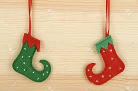 handmade christmas decorations felt elf shoes over wooden
