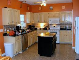Black And Oak Kitchen Cabinets - oak kitchen cabinets with granite countertops and black appliances