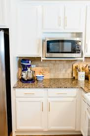 painting kitchen cabinets process how to paint cabinets our cabinet painting process
