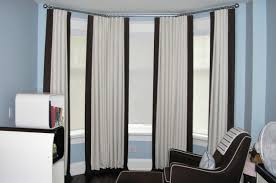 085 blackout off white linen drapes with dark brown band on the