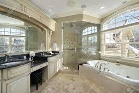 master bath in luxury home with glass shower stock photo picture