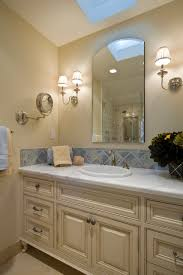 bathroom accent tile and sconce on beige wall plus blue tiles