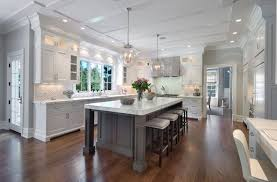 white kitchen cabinets grey island white and gray kitchen blue water home builders kitchen