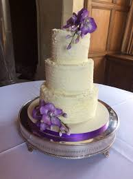 3 tier buttercream covered cake with textured finish and sprays of