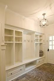 entryway built in cabinets like individual openings with drawers beneath and shelves above