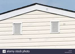 attic ventilation on the side of the roof stock photo royalty
