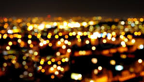 orange bokeh from the lights of the city stock photo