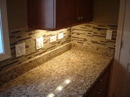 cozy countertop design with giallo ornamental granite mosaic tile