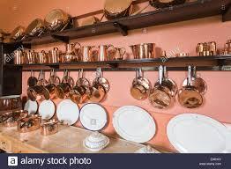 shiny copper kitchen utensils pots pans saucepans jugs white