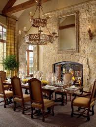 Tuscan Style Dining Room Furniture Tuscan Style Dining Room With Stacked Fireplace And Sconces