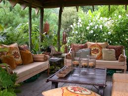 peaceful backyard landscaping idea with patio furniture set and