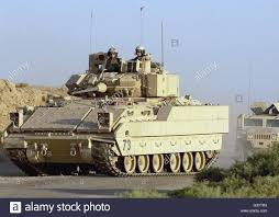 armored humvee a convoy of bradley and humvee armored vehicles stock photo