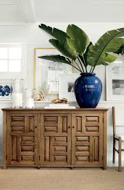 809 best life s a beach beach houses beach cottages home coastal vignette featuring beautiful palm leaves resting in a beauitful blue vase