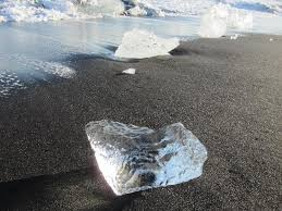 ice on a black sand beach at jökulsárlón picture of iceland