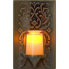 plug in candle night light ge led candle night light auto on off faux bronze jasco