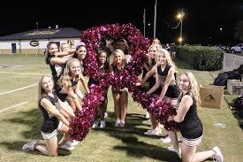 cheerleaders show awareness by wearing pink u2013 the greer hive times