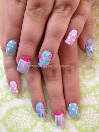 pastel pink blue and white freehand nail art with polka dots