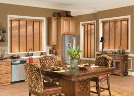 decorating tan wall with glass dor with faux wood blinds matched