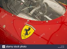 ferrari horse logo ferrari prancing horse logo on a red racing car stock photo