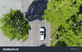 dark green station wagon aerial following car topdown view this stock photo 655475701