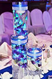 Blue Wedding Centerpieces by Submerged Blue Orchids With Bling Wrap Trimmed Vases Can Top With