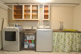 unfinished laundry room makeover design with custom table storage