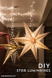 hanging star lanterns a christmas front porch decorating idea