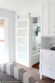 love this sliding door for the bathroom takes up less space than