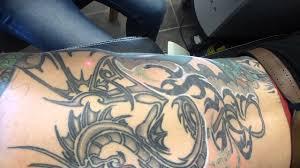 tattoo removal big black tribal on back youtube