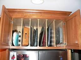 kitchen cabinet tray dividers maybe i don t need a pull out tray divider and putting them above