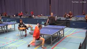 los angeles table tennis club ping pong shot bounces back at table tennis player at competition in