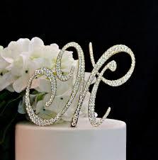 k cake topper monogram gold wedding cake topper decorated with swarovski