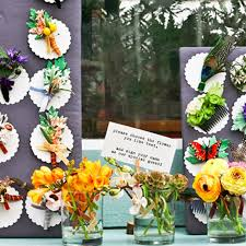 a fresh way to use wedding flowers boutonnieres for your guests