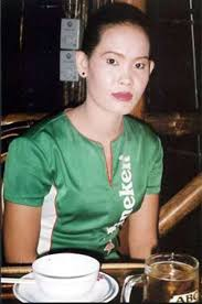 AIDS IN ASIA  The Continent     s Growing Crisis   WORKERS AT RISK     A Heineken  quot beer girl quot  in Phnom Penh spends her nights trying to convince men