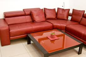 livingroom candidate luxutr red faux leather sofa mixed white cushions and chromed