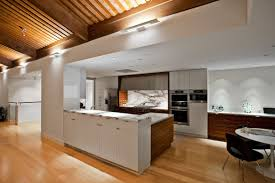 modern log home interiors super modern white kitchen and dining space in a log cabin house