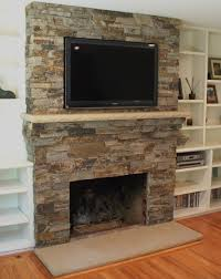 new design stone fireplace surround with a flatscreen tv