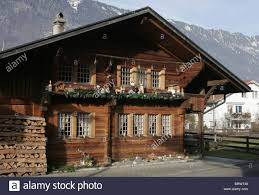 wooden house in switzerland with christmas decorations outside