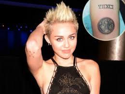 miley cyrus gets new tattoo as da vinci heart