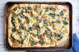 halloween pizza background spinach and artichoke sheet pan pizza simplyrecipes com