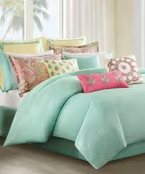 image of coral and turquoise bedding stylish craft room