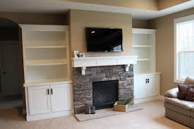 built in bookcases beside fireplace home design ideas
