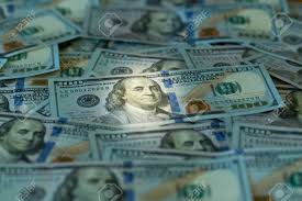 design of us currency one hundred dollar bills laid out on