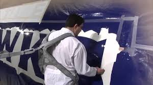 time lapse video of boeing painting a 747 into seahawks colors
