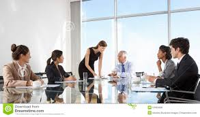 Board Meeting Table Group Of Business People Having Board Meeting Around Glass Table