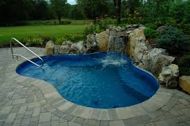 natural vintage stone plus water curtain in backyard pool ideas