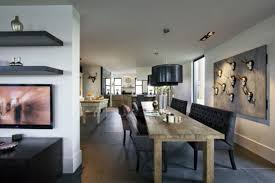 long grey wooden dining table with black leather chair on ceramics