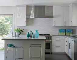 neutral kitchen with white glass subway tles and wall cabinets