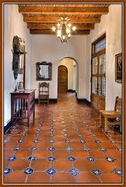 love the saltillo and tile floor and the ceiling treatment i