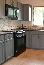 gray kitchen cabinets with black stainless steel appliances black appliances and white or gray cabinets how to make it